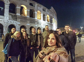 Angle180 team, taking a selfie at the Colosseum after a day of exploring Rome